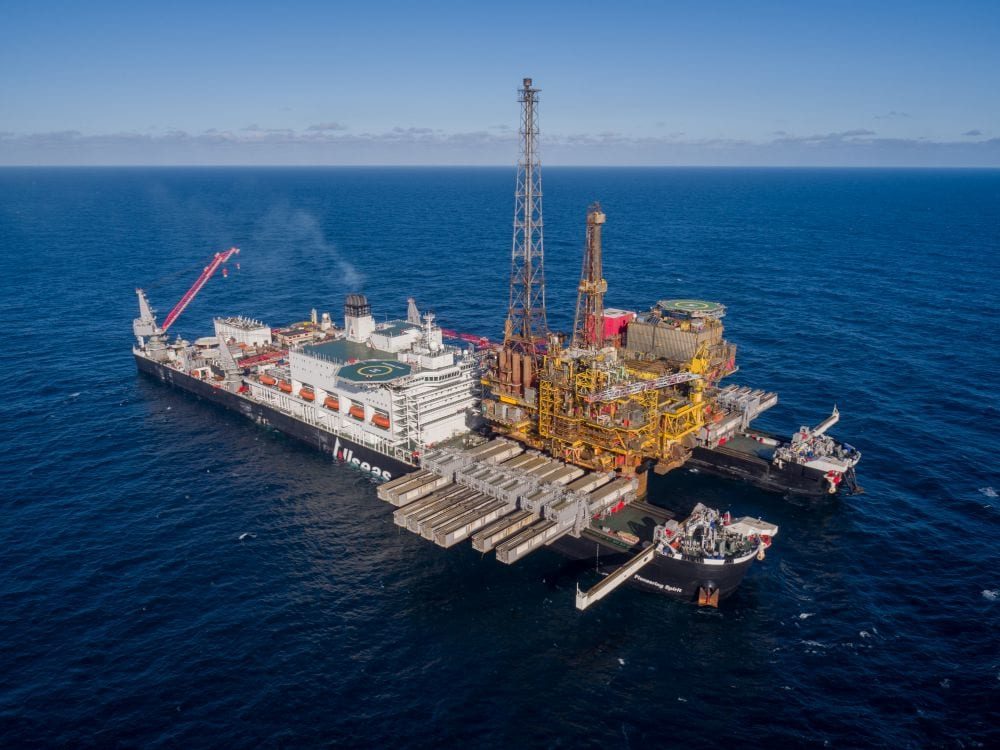 An aerial view of Pioneering Spirit with the topside of Brent Delta on board.