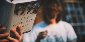Student reading The Odyssey